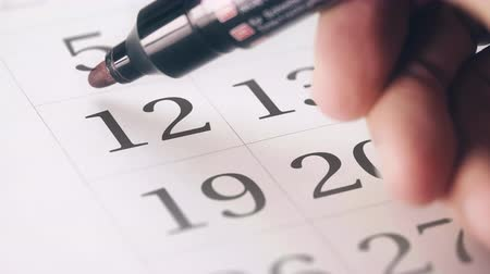 напоминать : Drawing red circled mark on the twelfth 12 day of a month in the calendar