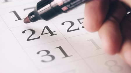 hatırlatmak : Drawing red circled mark on the twenty-fourth 24 day of a month in the calendar