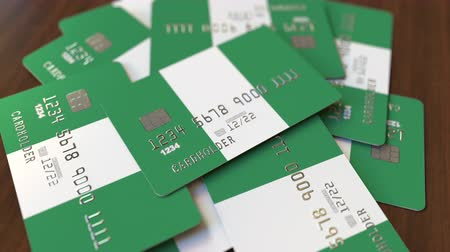 nigeria flag : Pile of credit cards with flag of Nigeria. Nigerian banking system conceptual 3D animation Stock Footage