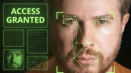 zkontrolovat : Computer system scans mans face and identifies person. Access granted