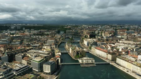 geneva : GENEVA, SWITZERLAND - APRIL 27, 2019. Aerial shot of Geneva on the right bank of the Rhone river Stock Footage
