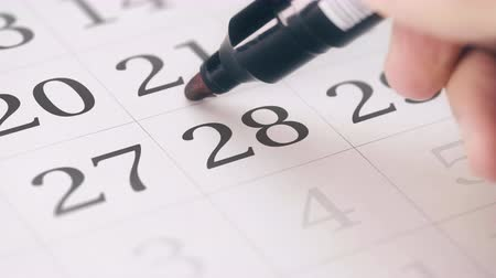 terms : Marked the twenty-eighth 28 day of a month in the calendar transforms into DUE DATE reminder