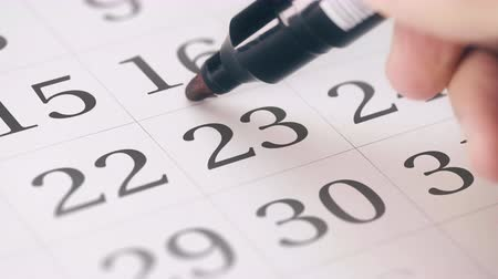 três : Marked the twenty-third 23 day of a month in the calendar transforms into DUE DATE reminder Stock Footage