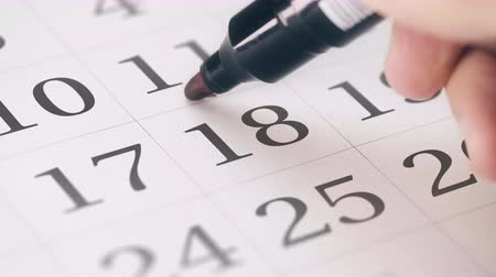 eighteen : Marked the eighteenth 18 day of a month in the calendar transforms into DUE DATE reminder Stock Footage