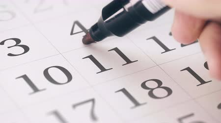 terms : Marked the eleventh 11 day of a month in the calendar transforms into DUE DATE reminder Stock Footage