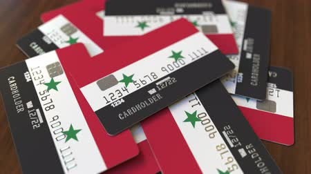 syrian : Pile of credit cards with flag of Syria. Syrian banking system conceptual 3D animation