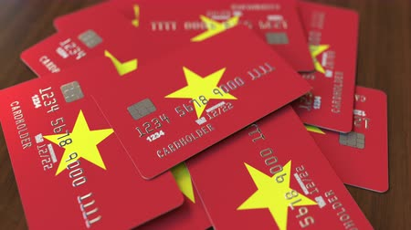 дебет : Pile of credit cards with flag of Vietnam. Vietnamese banking system conceptual 3D animation