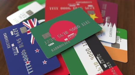 дебет : Many credit cards with different flags, emphasized bank card with flag of Bangladesh