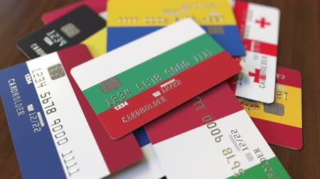 bolgár : Many credit cards with different flags, emphasized bank card with flag of Bulgaria