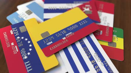 colômbia : Many credit cards with different flags, emphasized bank card with flag of Colombia Vídeos