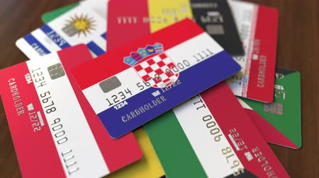 дебет : Many credit cards with different flags, emphasized bank card with flag of Croatia