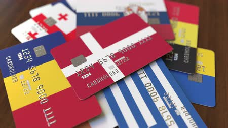 дебет : Many credit cards with different flags, emphasized bank card with flag of Denmark