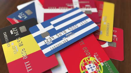 greek flag : Many credit cards with different flags, emphasized bank card with flag of Greece Stock Footage