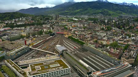 bahnhof : Aerial view of Bahnhof Luzern or Lucerne Main Station and many railroad tracks, Switzerland Stock Footage