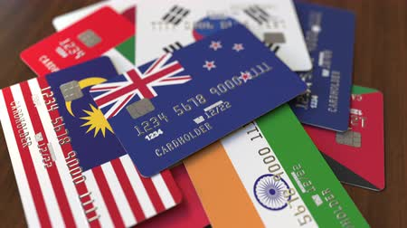 nowa zelandia : Many credit cards with different flags, emphasized bank card with flag of New Zealand