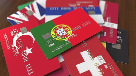 дебет : Many credit cards with different flags, emphasized bank card with flag of Portugal