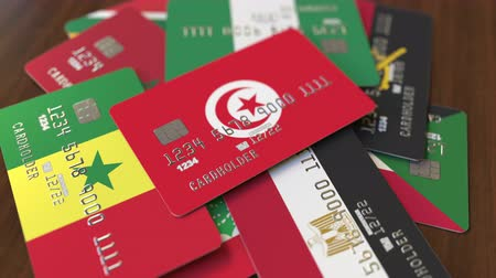 tunisia : Many credit cards with different flags, emphasized bank card with flag of Tunisia Stock Footage