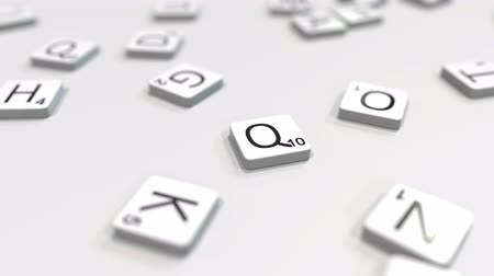 quito : Making QUITO city name with scrabble letter tiles. Editorial 3D animation