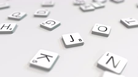 キャプション : Making JEDDAH city name with scrabble letter tiles. Editorial 3D animation