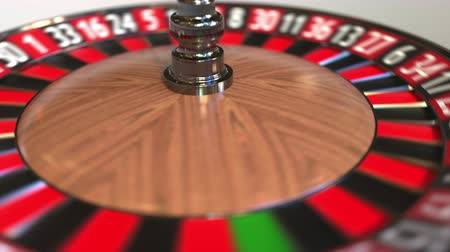 probabilidade : Casino roulette wheel ball hits 22 twenty-two black. 3D animation