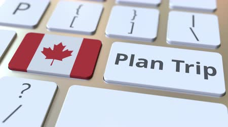 organizatör : PLAN TRIP text and flag of Canada on the computer keyboard, travel related 3D animation Stok Video