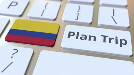 plánovač : PLAN TRIP text and flag of Colombia on the computer keyboard, travel related 3D animation