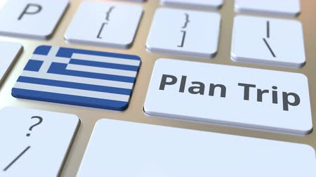 greek flag : PLAN TRIP text and flag of Greece on the computer keyboard, travel related 3D animation