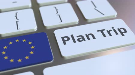 organizatör : PLAN TRIP text and flag of the European Union on the computer keyboard, travel related 3D animation Stok Video