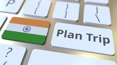 teclado : PLAN TRIP text and flag of India on the computer keyboard, travel related 3D animation Archivo de Video