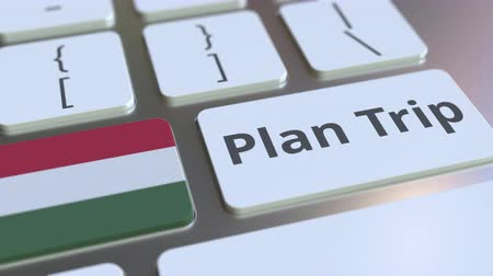 planejador : PLAN TRIP text and flag of Hungary on the computer keyboard, travel related 3D animation Vídeos