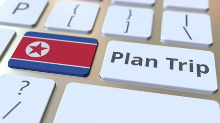 dprk : PLAN TRIP text and flag of North Korea on the computer keyboard, travel related 3D animation