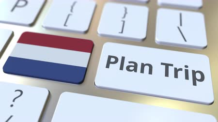посетитель : PLAN TRIP text and flag of the Netherlands on the computer keyboard, travel related 3D animation