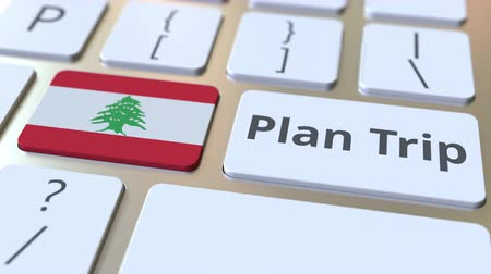 organizatör : PLAN TRIP text and flag of Lebanon on the computer keyboard, travel related 3D animation