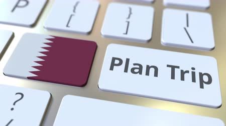 planejador : PLAN TRIP text and flag of Qatar on the computer keyboard, travel related 3D animation Vídeos