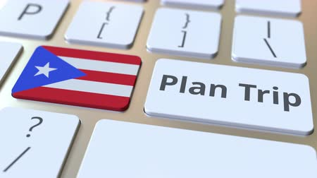 organizer : PLAN TRIP text and flag of Puerto Rico on the computer keyboard, travel related 3D animation