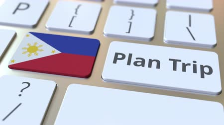 philippine : PLAN TRIP text and flag of Philippines on the computer keyboard, travel related 3D animation