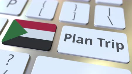 sudanian : PLAN TRIP text and flag of Sudan on the computer keyboard, travel related 3D animation Stock Footage