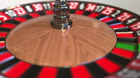 рулетка : Casino roulette wheel ball hits 1 one red. 3D animation