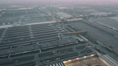 hangar : Aerial view of a big car factory in the evening