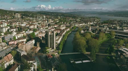 city limits : ZURICH, SWITZERLAND - APRIL 28, 2019. River Limmat within city limits, aerial view