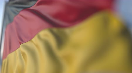 flap : Waving flag of Germany, shallow focus close-up. Realistic loopable 3D animation Stock Footage