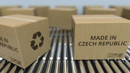 szállító : Boxes with MADE IN CZECH REPUBLIC text on roller conveyor. goods related loopable 3D animation Stock mozgókép