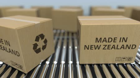 szállító : Cartons with MADE IN NEW ZEALAND text on roller conveyor. goods related loopable 3D animation