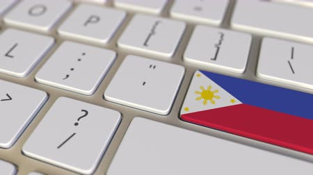 philippine : Key with flag of Philippines on the computer keyboard switches to key with flag of the USA, translation or relocation related animation Stock Footage