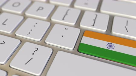 indie : Key with flag of India on the computer keyboard switches to key with flag of the USA, translation or relocation related animation