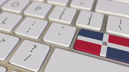 relocate : Key with flag of the Dominican Republic on the computer keyboard switches to key with flag of the USA, translation or relocation related animation