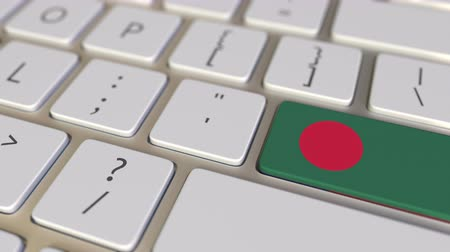 bengali : Key with flag of Bangladesh on the computer keyboard switches to key with flag of the USA, translation or relocation related animation