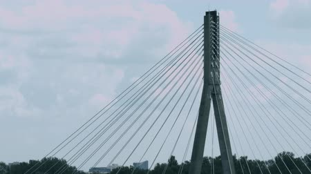 stayed : Top of cable-stayed bridge against curling clouds time lapse