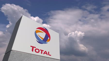 celkový : TOTAL logo on sky background, editorial animation