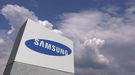 oficial : Logo of SAMSUNG on a stand against cloudy sky, editorial animation